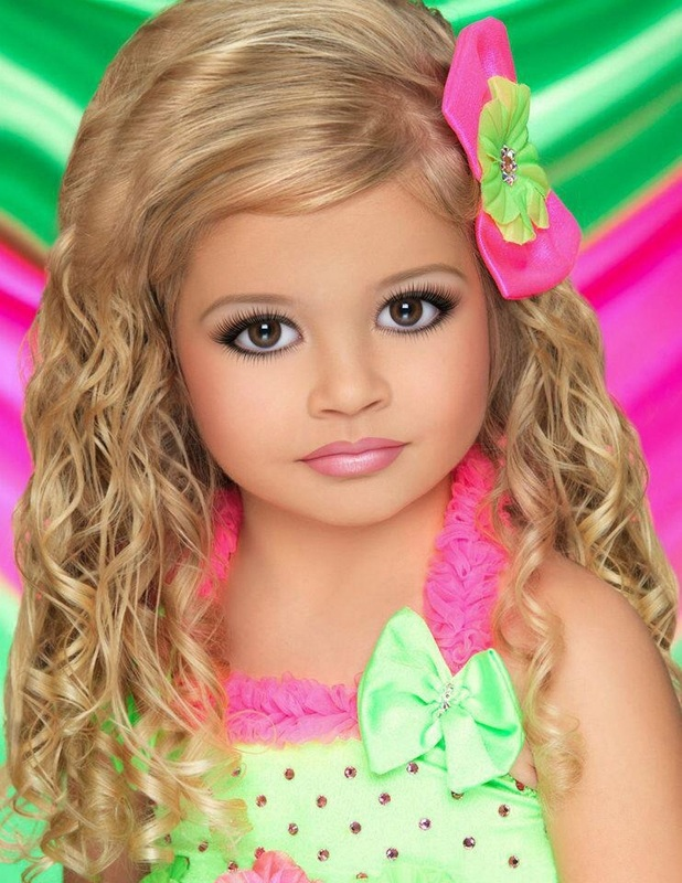 children in beauty pageants unrealistic photos of the child are required in the competition